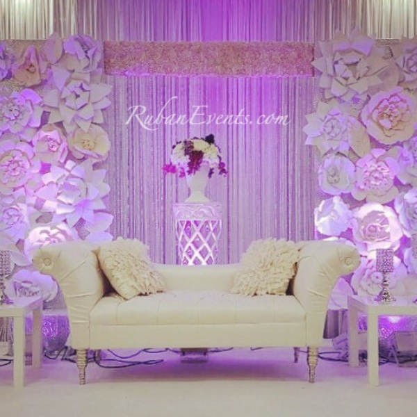 The trendi paper flower wall used to creat a dreamy environment for this young couple!